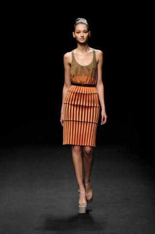 Clothing, Brown, Shoulder, Fashion show, Human leg, Joint, Style, Waist, Knee, Fashion model,