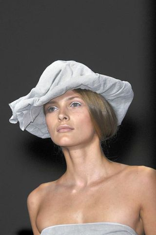 Nose, Lip, Shoulder, Headgear, Costume accessory, Strapless dress, Fashion, Beauty, Model, Photography,