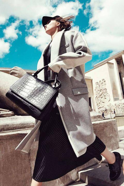 Street fashion, Bag, Vintage clothing, Goggles, Overcoat, Frock coat, Trench coat, Stock photography, Handbag,