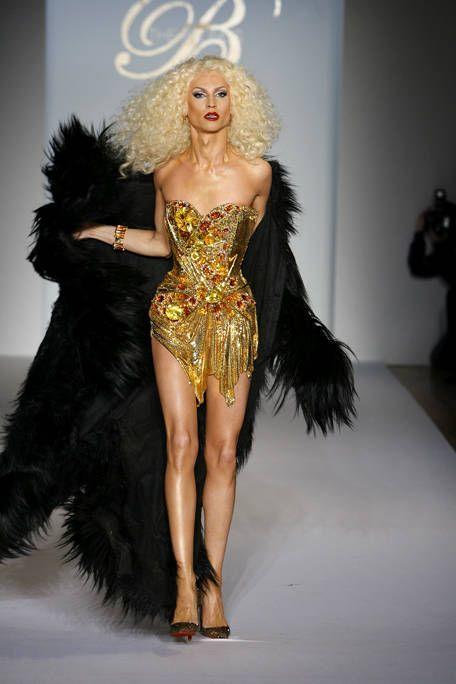 Human, Hairstyle, Dress, Fashion show, Fashion model, Waist, Fashion, Costume design, Runway, Model,