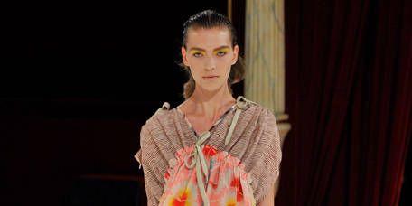 Clothing, Fashion show, Human body, Shoulder, Textile, Runway, Fashion model, Style, Curtain, Dress,