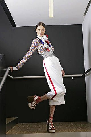 Standing, White, Style, Knee, High heels, Stairs, Sandal, Flight attendant, Fashion design, Ankle,