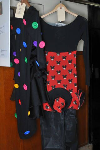 Sleeve, Collar, Textile, Clothes hanger, Fashion, Pattern, Jacket, Costume design, Fashion design, Button,