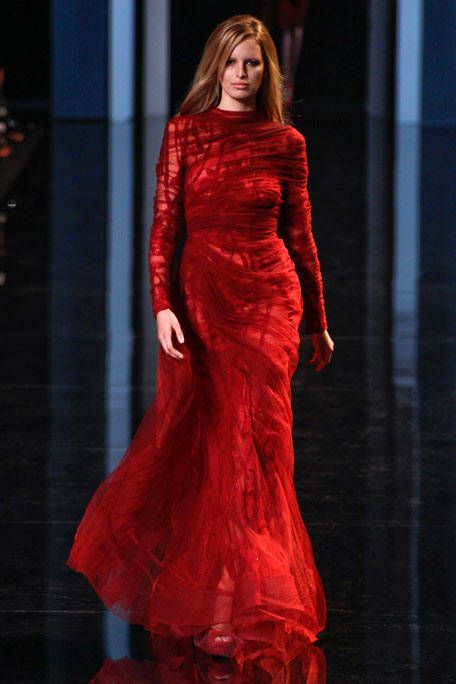 Red, Fashion model, Dress, Fashion, Model, Gown, Long hair, Red hair, One-piece garment, Haute couture,