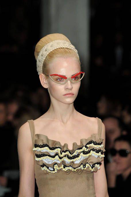 Eyewear, Lip, Shoulder, Style, Headgear, Fashion accessory, Fashion, Neck, Fashion model, Costume accessory,