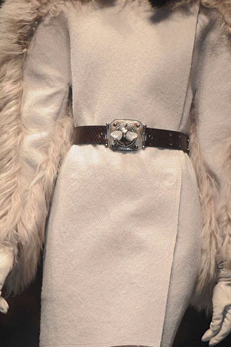 Textile, Collar, Natural material, Fashion, Beige, Fur, Fashion design, Silver, Embellishment, Pocket,