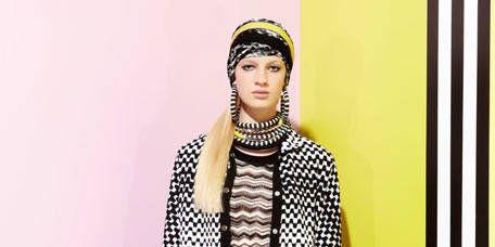 Yellow, Headgear, Fashion, Street fashion, Fur, Visual arts, Costume design, Beanie, Wrap, Fashion design,