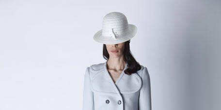 Sleeve, Shoulder, Human leg, Hat, Joint, White, Style, Knee, Collar, Fashion model,