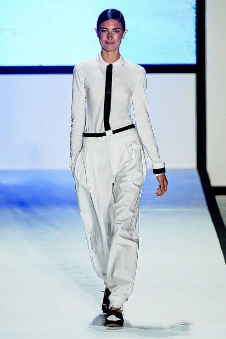 Blue, Dress shirt, Sleeve, Collar, Shoulder, Fashion show, Shirt, Joint, Standing, Formal wear,