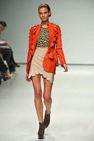 Leg, Fashion show, Human body, Shoulder, Runway, Human leg, Joint, Outerwear, Fashion model, Style,