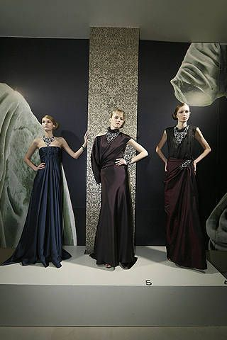 Clothing, Sleeve, Human body, Dress, Textile, Standing, Formal wear, Style, Gown, One-piece garment,