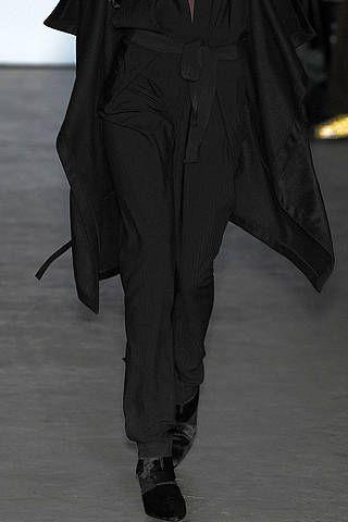 Sleeve, Style, Collar, Black, Pocket, Fashion model, Fashion design, Suit trousers, Haute couture, Button,