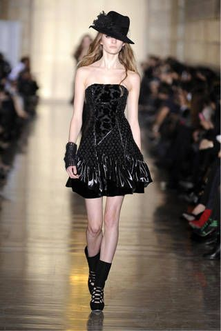 Clothing, Hat, Dress, Shoulder, Joint, Human leg, Fashion show, Style, Formal wear, Waist,