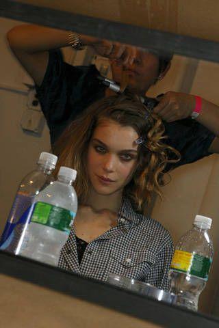 Hairstyle, Bottle, Shirt, Plastic bottle, Drinkware, Drink, Water bottle, Drinking water, Bottled water, Long hair,