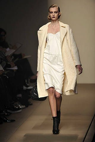 Clothing, Footwear, Fashion show, Joint, Outerwear, Fashion model, Style, Runway, Fashion, Knee,