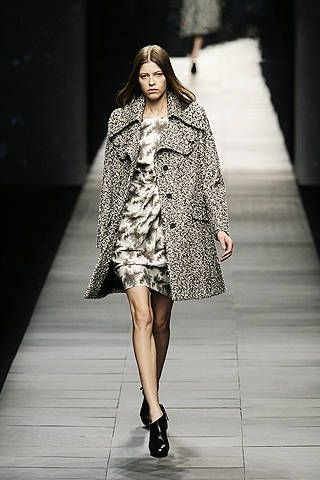 Clothing, Fashion show, Shoulder, Human leg, Dress, Runway, Style, Fashion model, One-piece garment, Fashion,