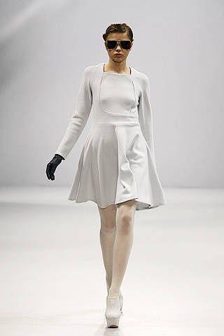 Clothing, Eyewear, Sleeve, Shoulder, Joint, Human leg, White, Sunglasses, Fashion model, Dress,