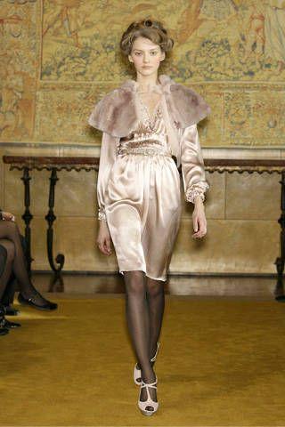Joint, Style, Fashion, Vintage clothing, Fashion model, Fur, Leather, Waist, Fashion design, One-piece garment,