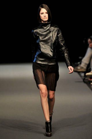 Brown, Sleeve, Human body, Fashion show, Human leg, Shoulder, Runway, Textile, Joint, Outerwear,