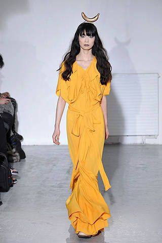 Yellow, Style, Formal wear, Costume accessory, Fashion model, Fashion, Youth, Costume design, Long hair, Horn,
