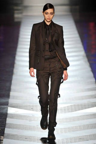 Clothing, Brown, Human body, Textile, Standing, Fashion show, Outerwear, Style, Collar, Formal wear,