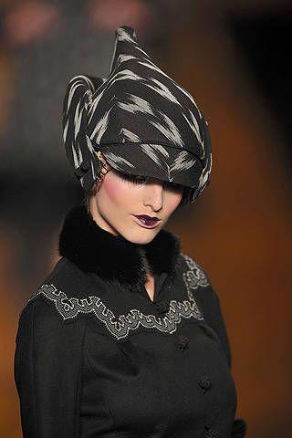 Headgear, Costume accessory, Fashion, Headpiece, Costume design, Portrait, Fashion design, Body jewelry, Silver, Portrait photography,
