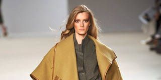 Brown, Sleeve, Shoulder, Textile, Joint, Fashion show, Style, Fashion model, Costume design, Fashion,