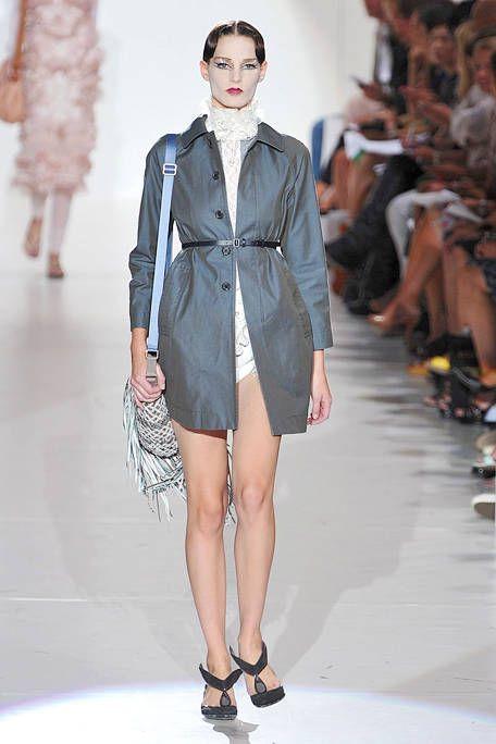 Clothing, Leg, Fashion show, Shoulder, Human leg, Textile, Joint, Outerwear, Runway, Dress,