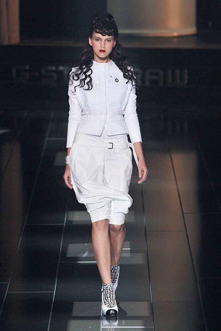 Clothing, Sleeve, Human leg, Shoulder, Fashion show, Joint, White, Runway, Fashion model, Style,