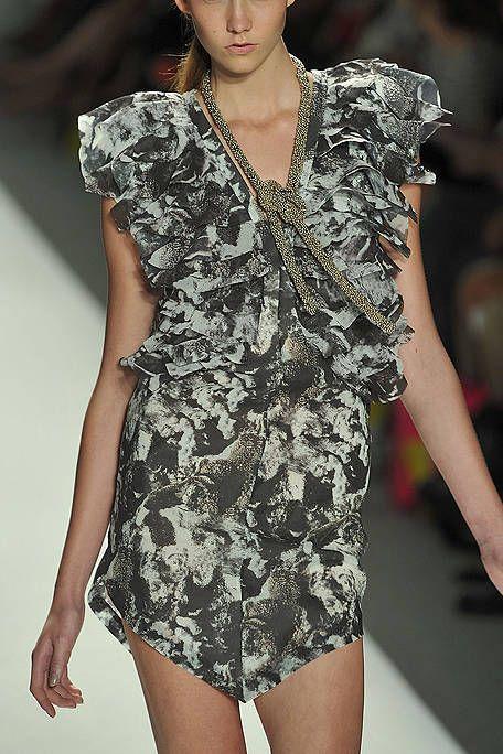 Dress, Shoulder, Joint, One-piece garment, Fashion model, Fashion show, Day dress, Cocktail dress, Fashion, Pattern,