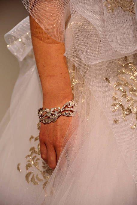 Finger, Bridal clothing, Skin, Bridal accessory, Wrist, Wedding dress, Bride, Jewellery, Ceremony, Nail,