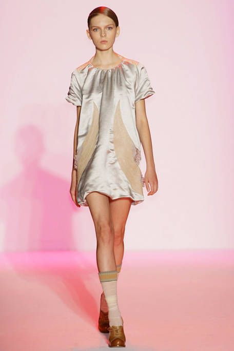 Leg, Human, Skin, Sleeve, Human leg, Fashion show, Shoulder, Joint, Dress, Runway,