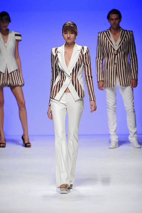 Clothing, Leg, Blue, Sleeve, Human body, Trousers, Fashion show, Shoulder, Joint, Outerwear,