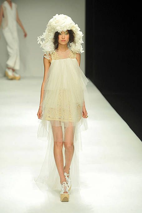 Clothing, Footwear, Hairstyle, Shoulder, Fashion show, White, Dress, Runway, Style, Fashion model,