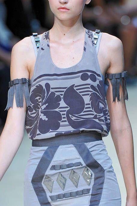 Sleeveless shirt, Fashion, Street fashion, Active tank, Undershirt, Chest, Fashion design, Fashion model, Model,