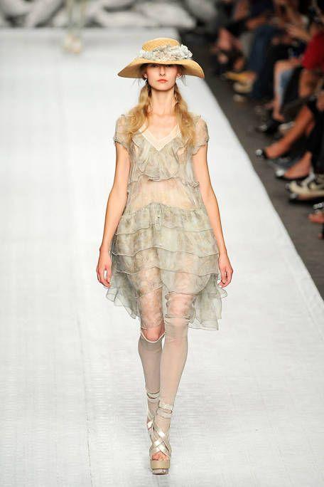 Clothing, Footwear, Leg, Human, Fashion show, Hat, Shoulder, Human leg, Runway, Joint,