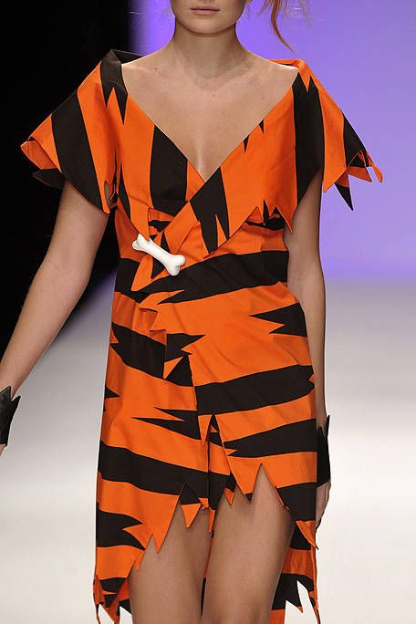 Orange, Shoulder, Joint, Dress, Fashion model, One-piece garment, Amber, Fashion show, Day dress, Fashion,