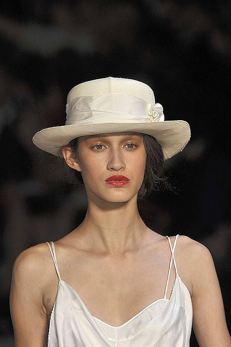 Clothing, Nose, Lip, Hat, Skin, Shoulder, Joint, Headgear, Fashion accessory, Beauty,