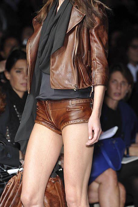 Leg, Brown, Human leg, Textile, Jacket, Outerwear, Fashion show, Style, Thigh, Fashion model,