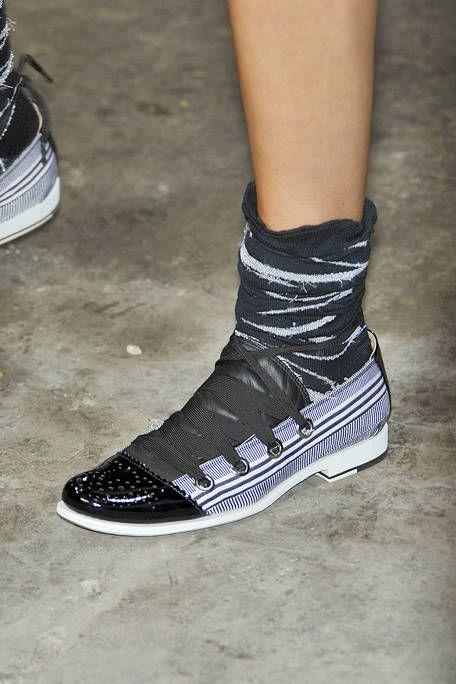 Human leg, Shoe, White, Style, Grille, Athletic shoe, Fashion, Automotive lighting, Black, Grey,