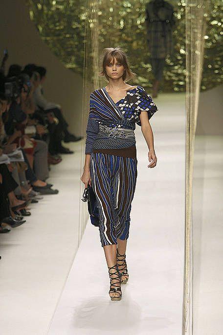 Clothing, Footwear, Leg, Fashion show, Shoulder, Runway, Joint, Style, Dress, Fashion model,