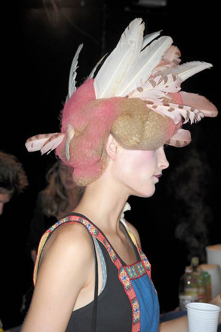 Hairstyle, Sleeveless shirt, Pink, Feather, Hair accessory, Headpiece, Headgear, Eyelash, Costume accessory, Fashion,