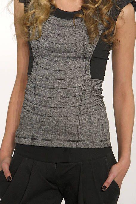 Sleeve, Shoulder, Standing, Joint, Waist, Style, Sleeveless shirt, Trunk, Fashion, Neck,
