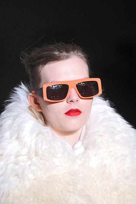 Eyewear, Vision care, Lip, Hairstyle, Sunglasses, Eyebrow, Textile, Earrings, Goggles, Fashion accessory,