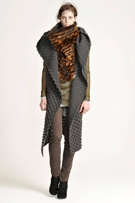 Brown, Sleeve, Human body, Shoulder, Textile, Joint, Standing, Style, Knee, Pattern,