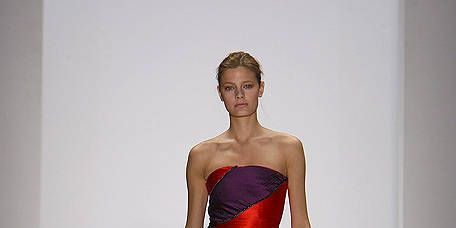 Clothing, Leg, Dress, Human leg, Shoulder, Fashion show, Joint, Waist, One-piece garment, Fashion model,