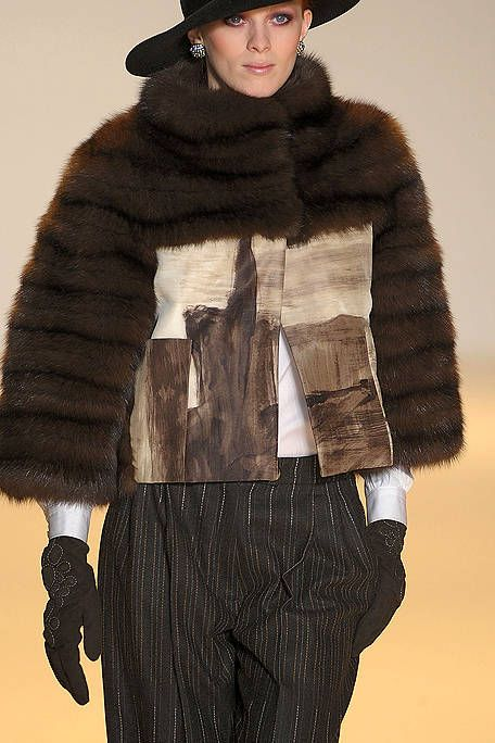 Sleeve, Textile, Fur clothing, Jacket, Headgear, Costume accessory, Natural material, Fashion, Winter, Animal product,