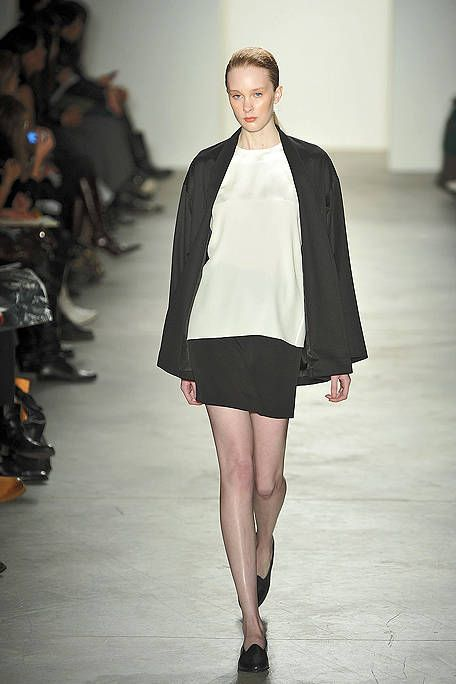 Leg, Sleeve, Fashion show, Shoulder, Human leg, Runway, Joint, Outerwear, Fashion model, Style,