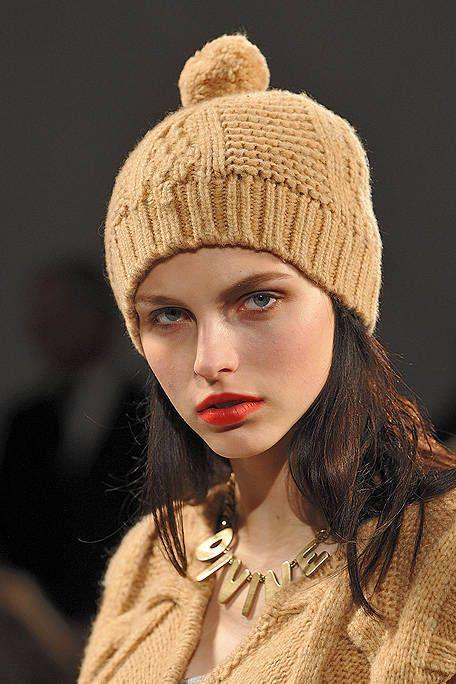 Lip, Brown, Textile, Style, Headgear, Eyelash, Fashion accessory, Fashion, Knit cap, Jewellery,
