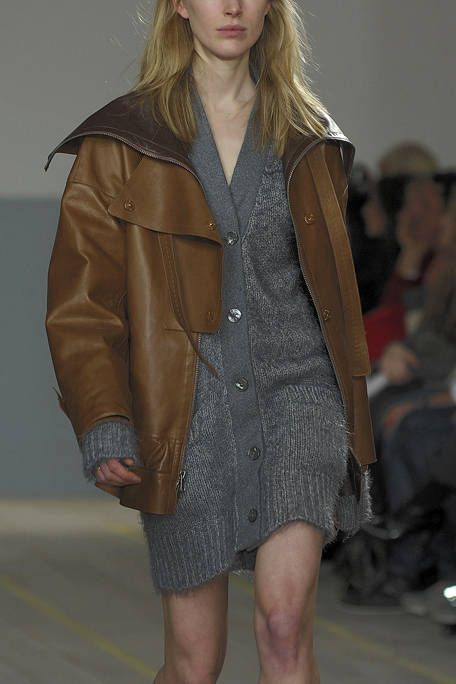 Clothing, Brown, Sleeve, Human body, Shoulder, Textile, Joint, Outerwear, Jacket, Style,